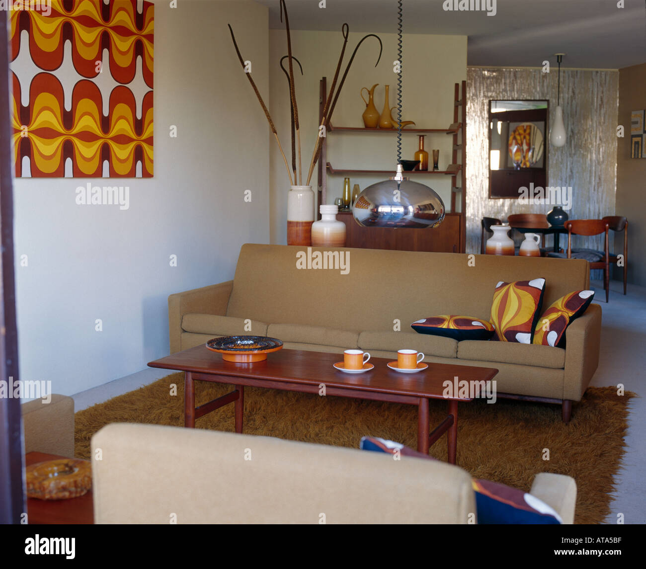 Retro style house in Elizabeth Bay. Living room with coffee table and four seater sofa. - Stock Image