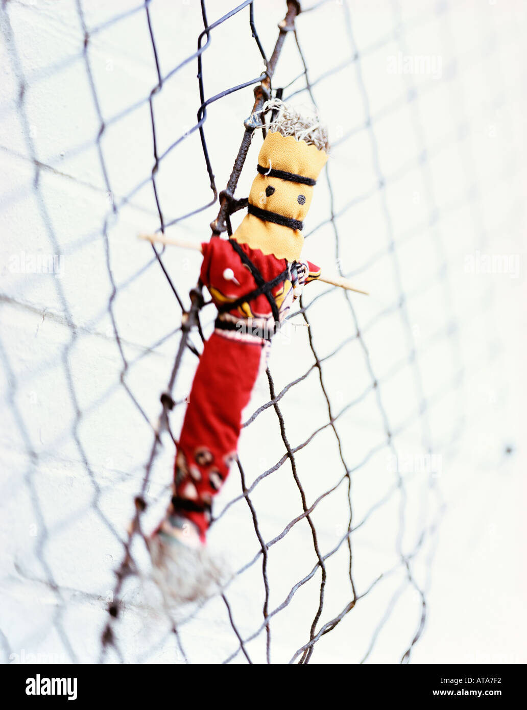 voodoo doll on fence - Stock Image