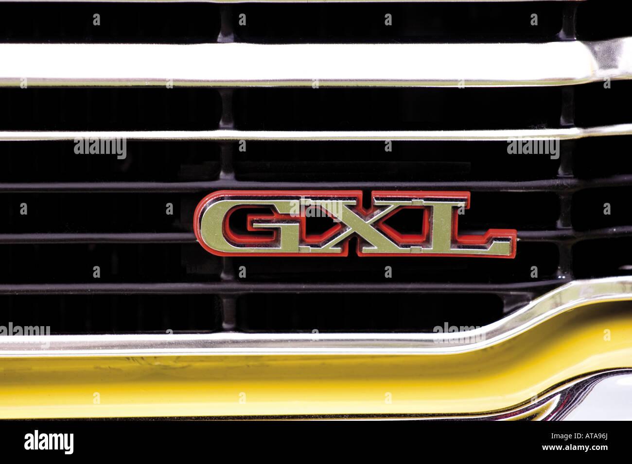 Ford Cortina mk3 mark III three yellow detail badge logo GXL on grille radiator chrome black gloss close up - Stock Image