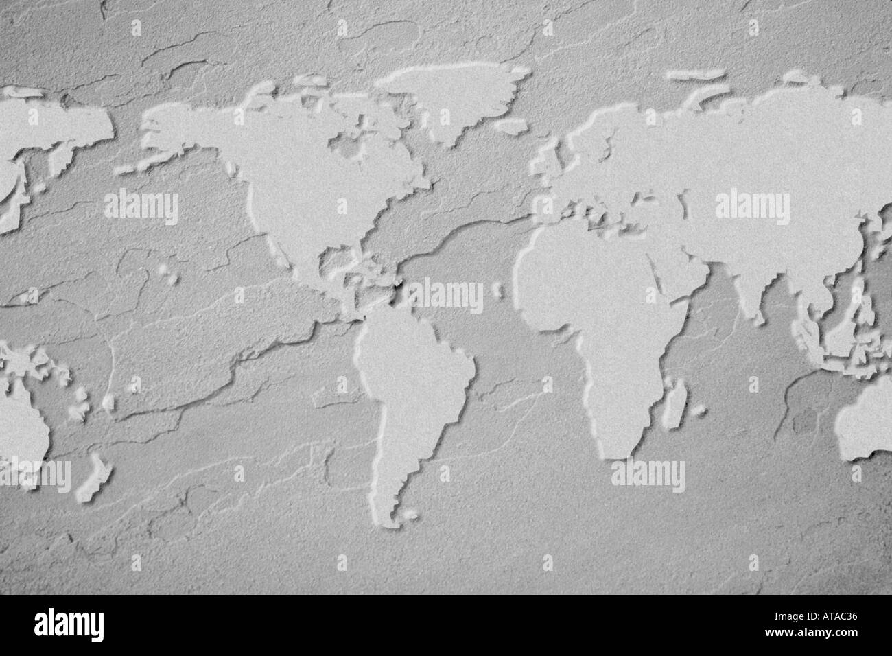 Outline of earth map on flagstone - Stock Image