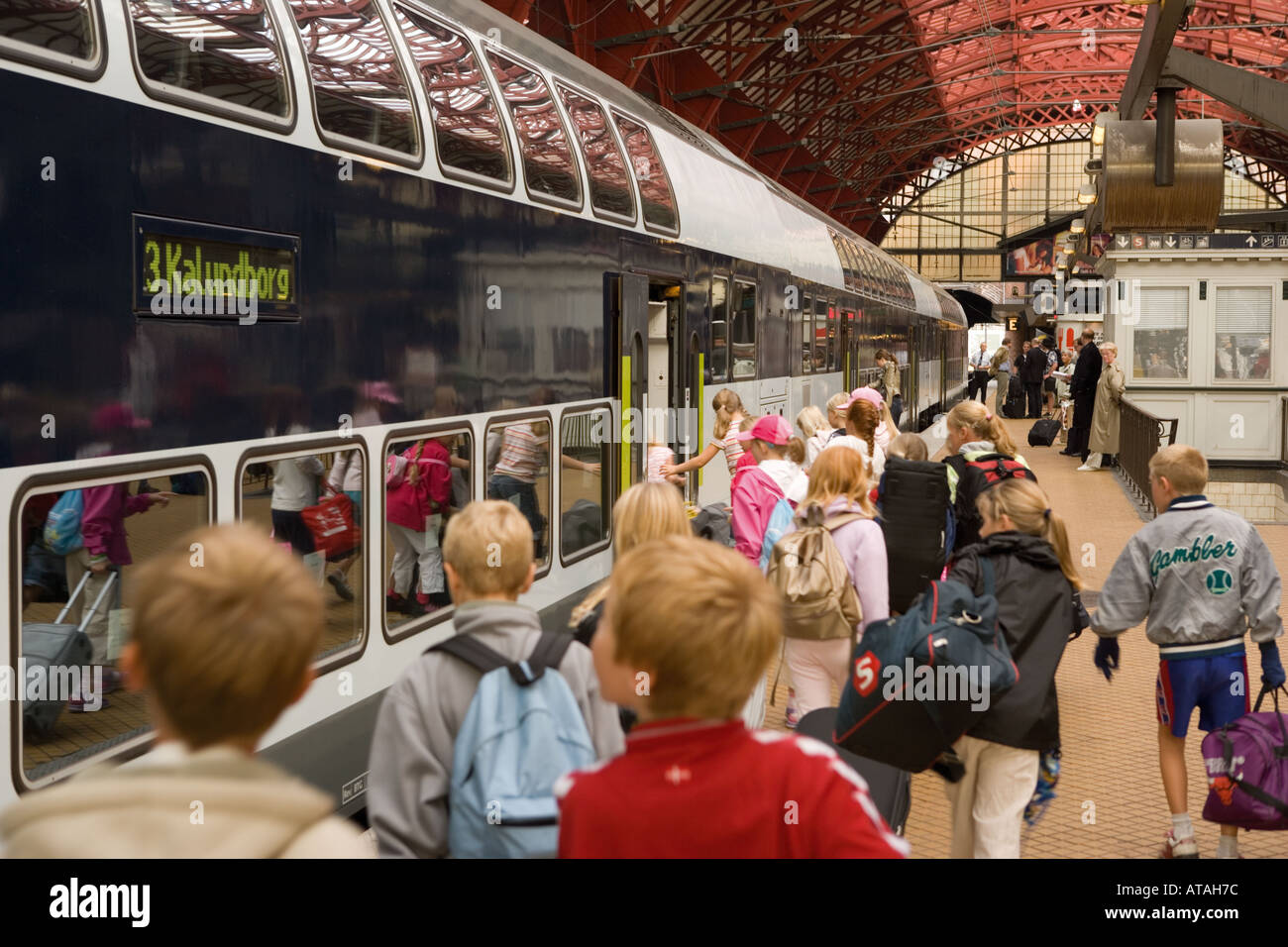 Copenhagen Denmark Passengers boarding train from platform in central railway station - Stock Image