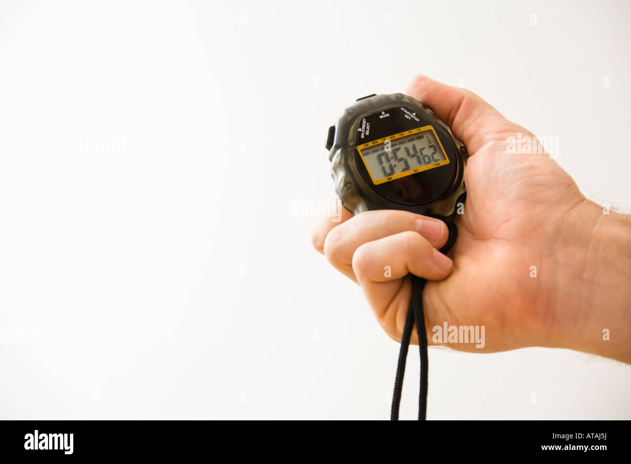 Close up of adult male hand holding stopwatch - Stock Image