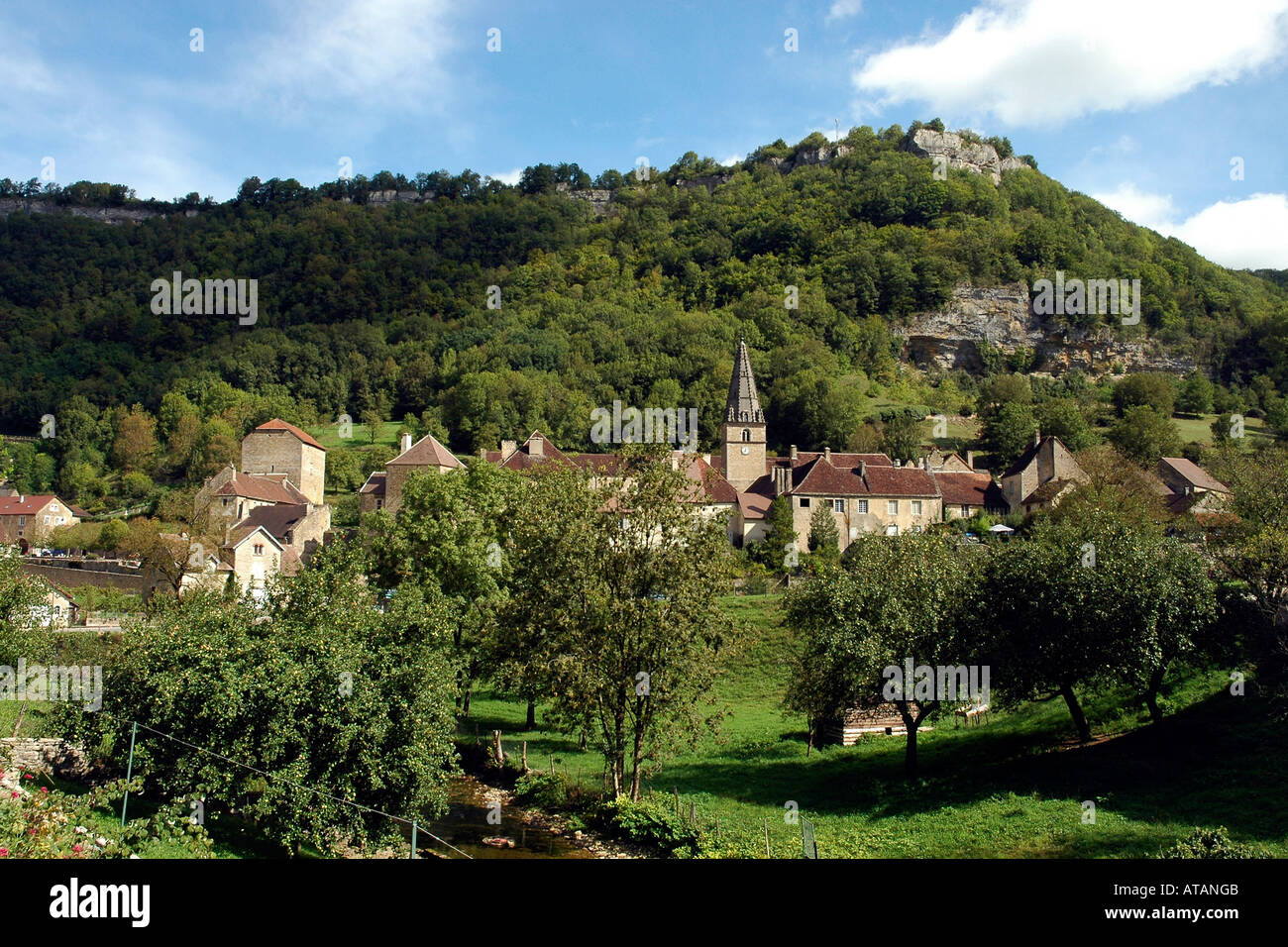 The 9th-century abbey in the village of Baume-les-Messieurs deep in the Cirque de Baume in France's Jura region - Stock Image