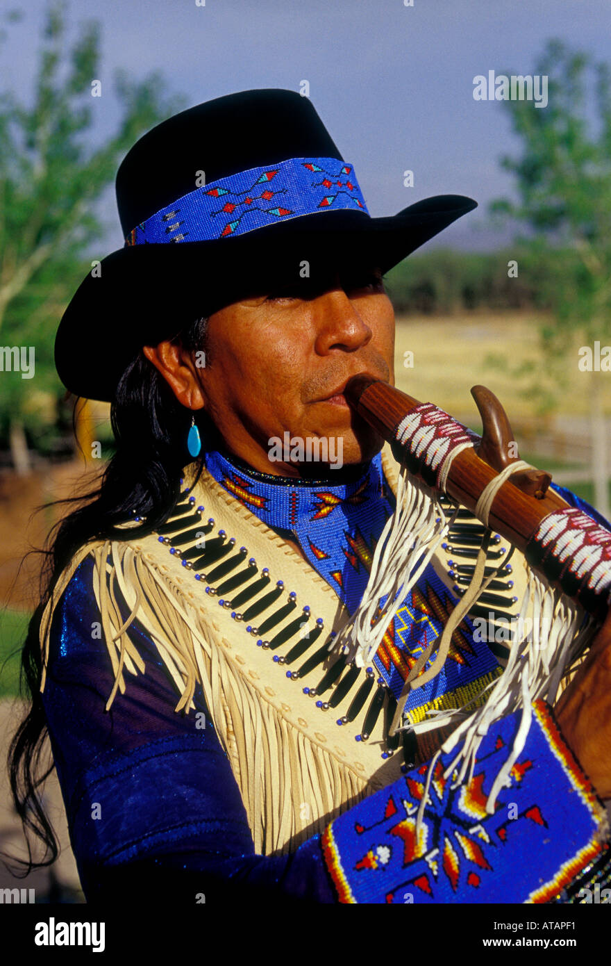 Allenroy Paquin, Native American Indian, Native American, artist, musician, playing flute, flute player, flutist, Stock Photo