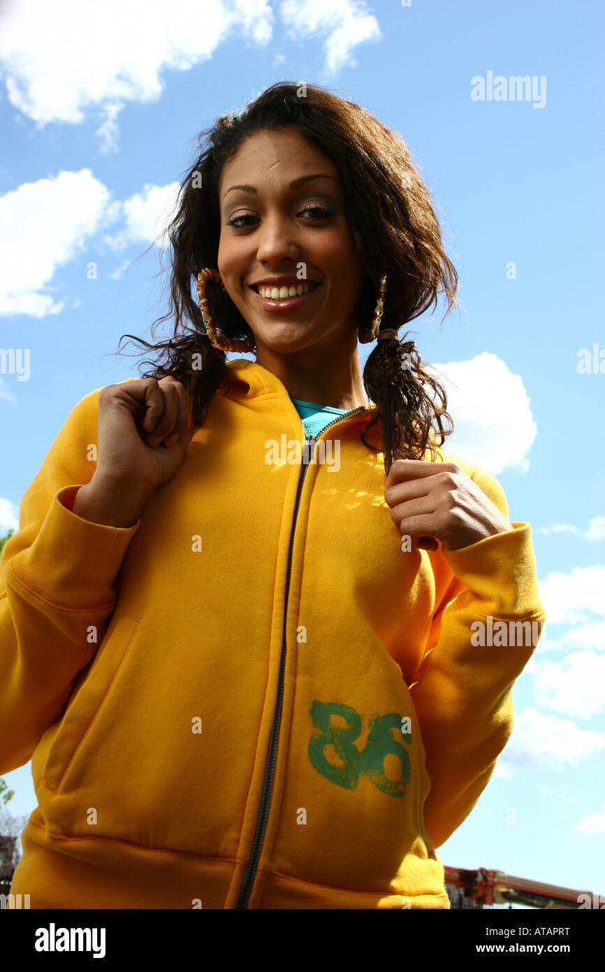 PRETTY YOUNG WOMAN ENJOYING THE OUTDOORS - Stock Image
