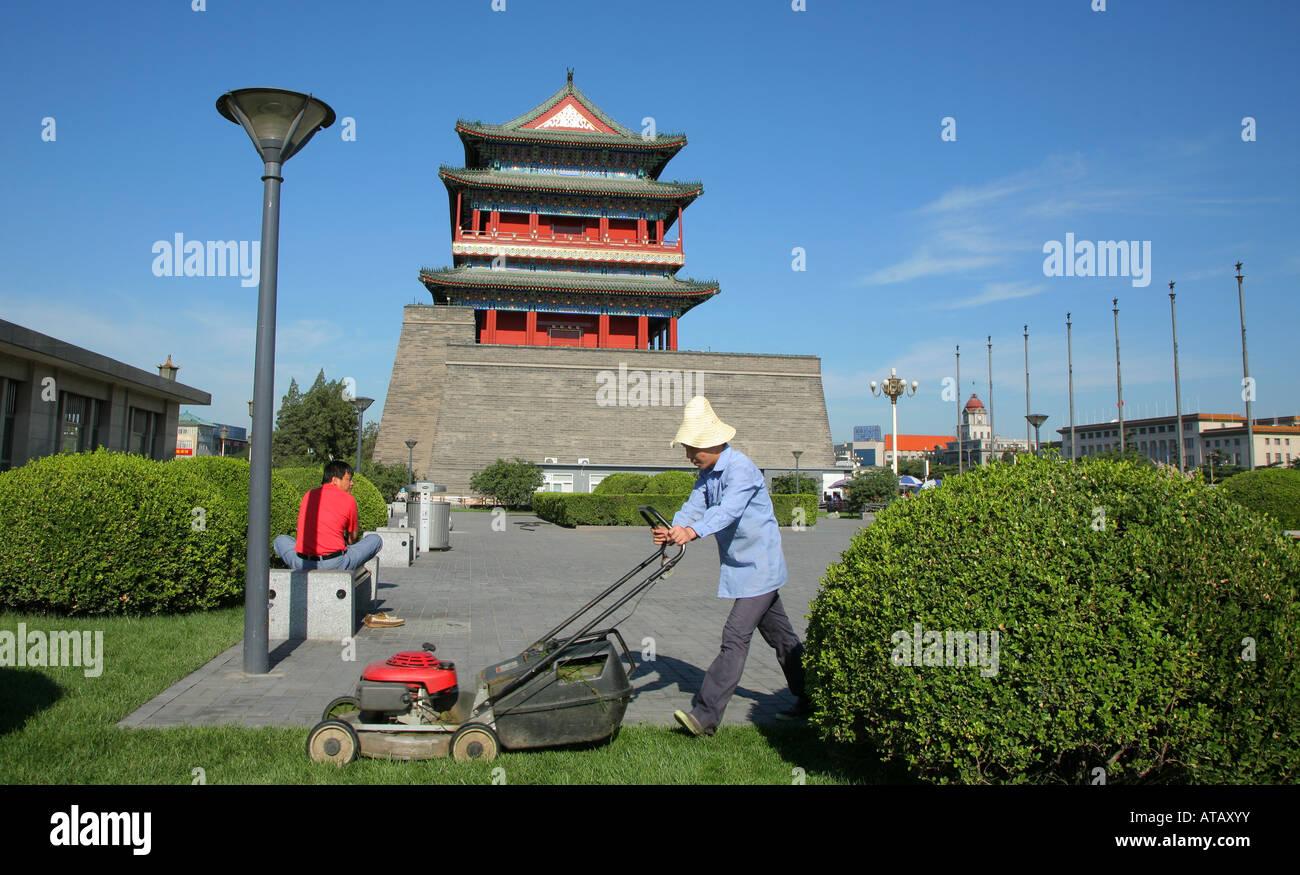 Gardener mowing lawn Front Gate Tiananmen Square Beijing China - Stock Image