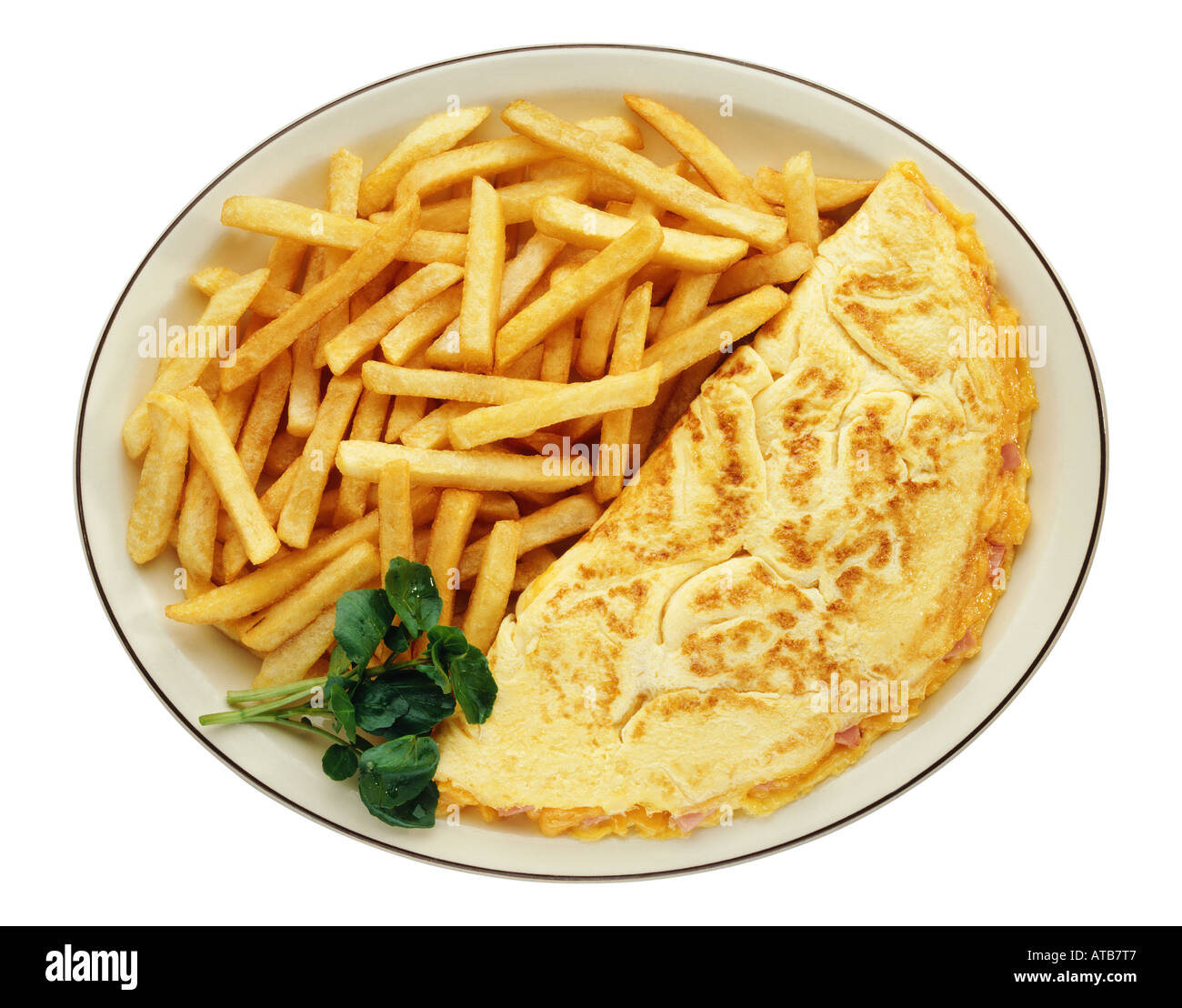 An omelet and French fries on a plate - Stock Image