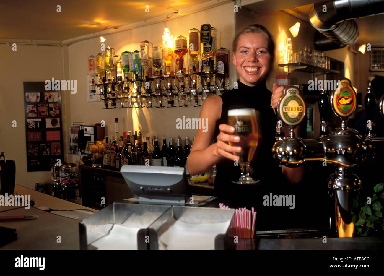 Denmark Copenhagen Barman serves beer at Kys cafe - Stock Image