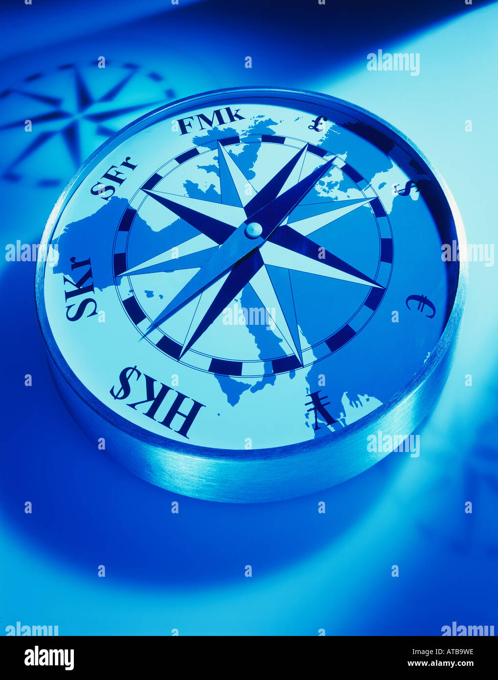 A compass with international currency points - Stock Image