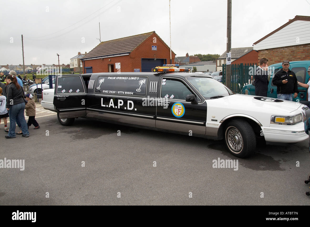 tacky stretched limo limoscene america car hen night done out as police car crass bad taste - Stock Image
