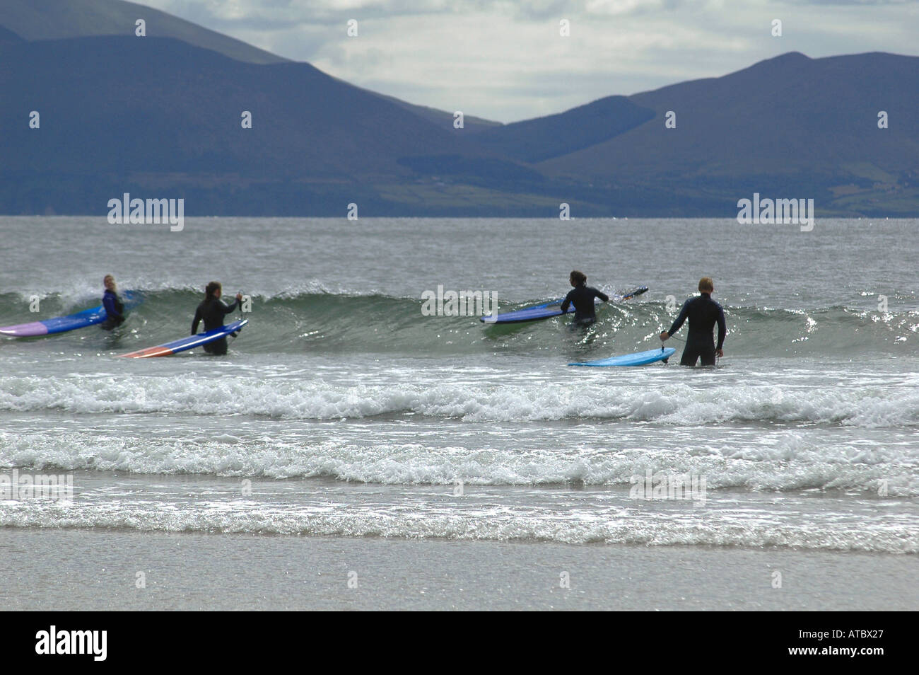 Family play time on the huge beach of INCH where cars can be parked while swimming or surfing Co Kerry Ireland - Stock Image