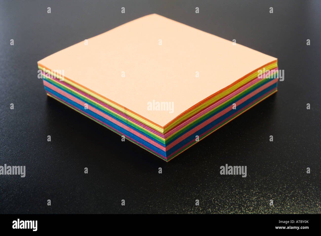 Stack of multicolored paper, close-up - Stock Image
