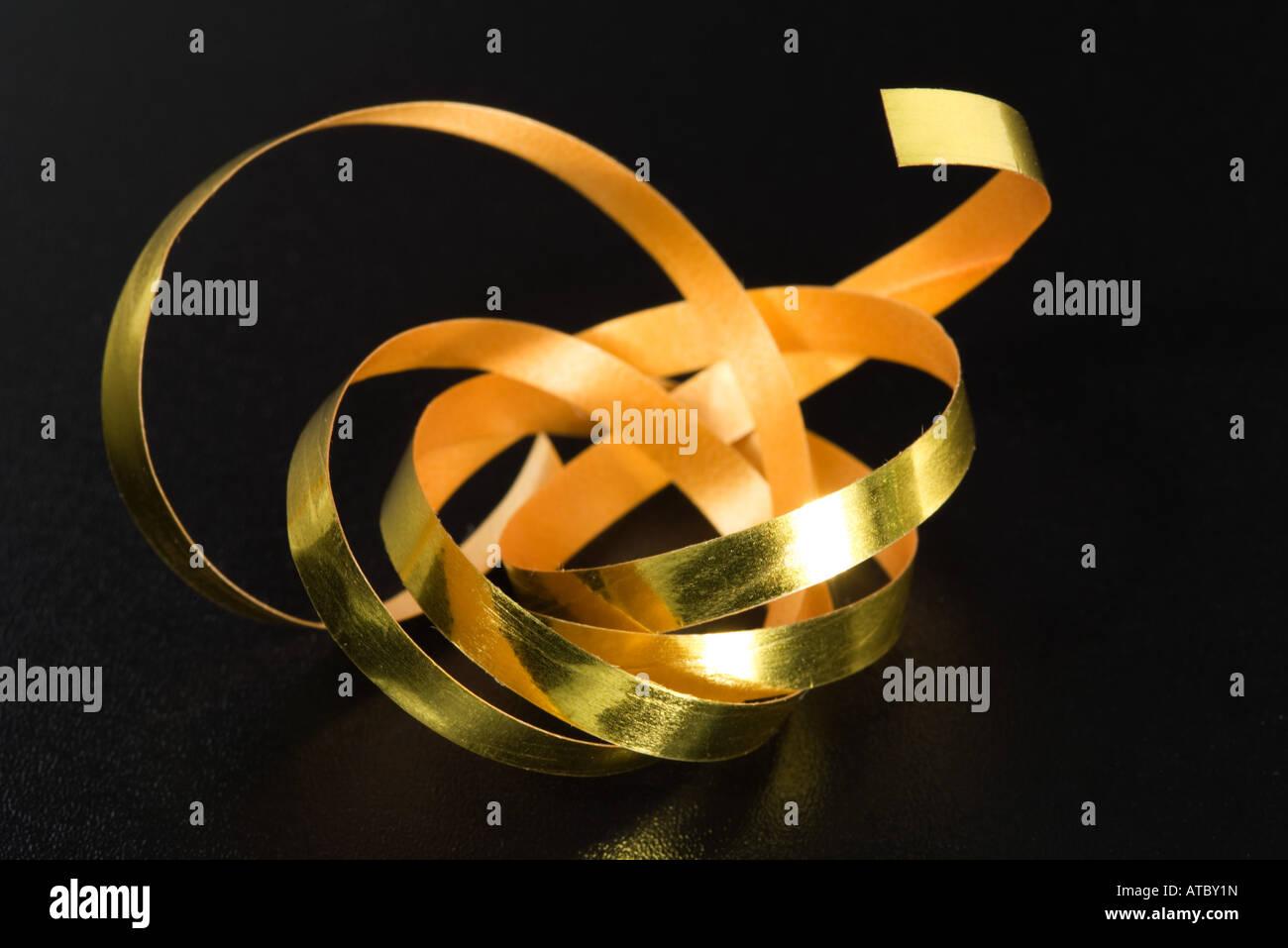 Gold gift-wrap ribbon - Stock Image
