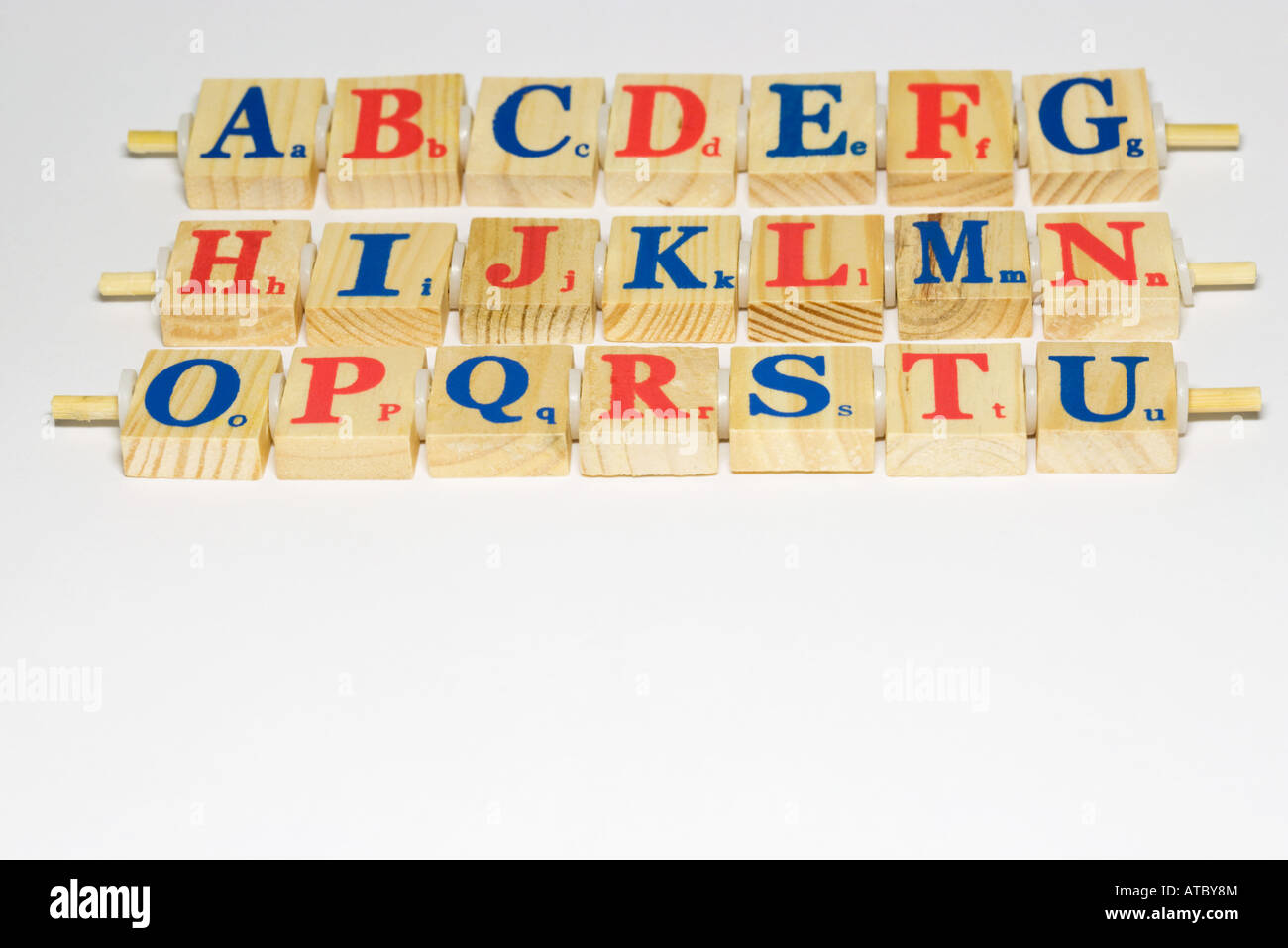 Wooden alphabet blocks in rows, close-up - Stock Image