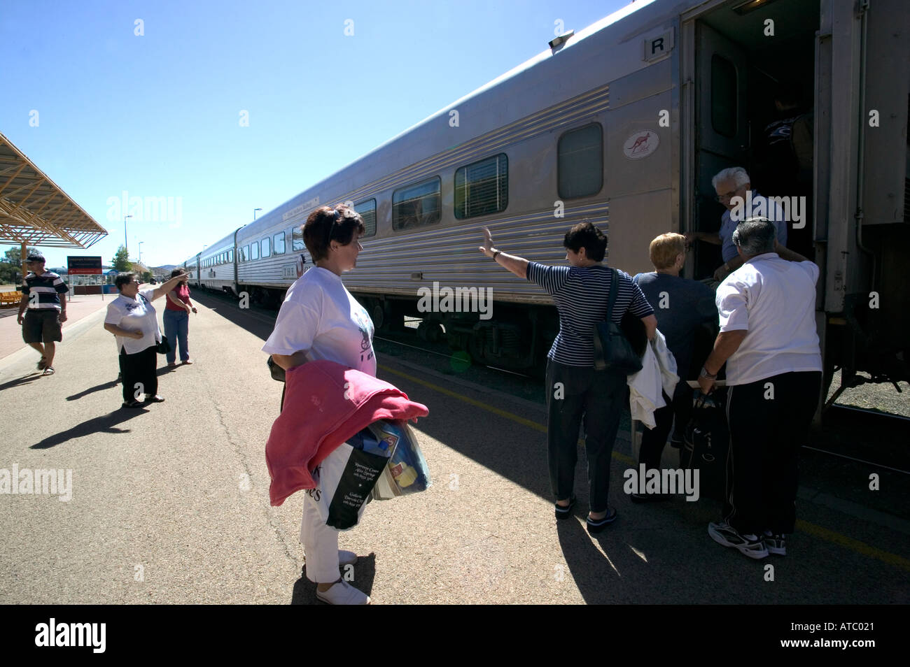 Passengers get ready to depart on board the Ghan train in Katherine station in outback Australia - Stock Image