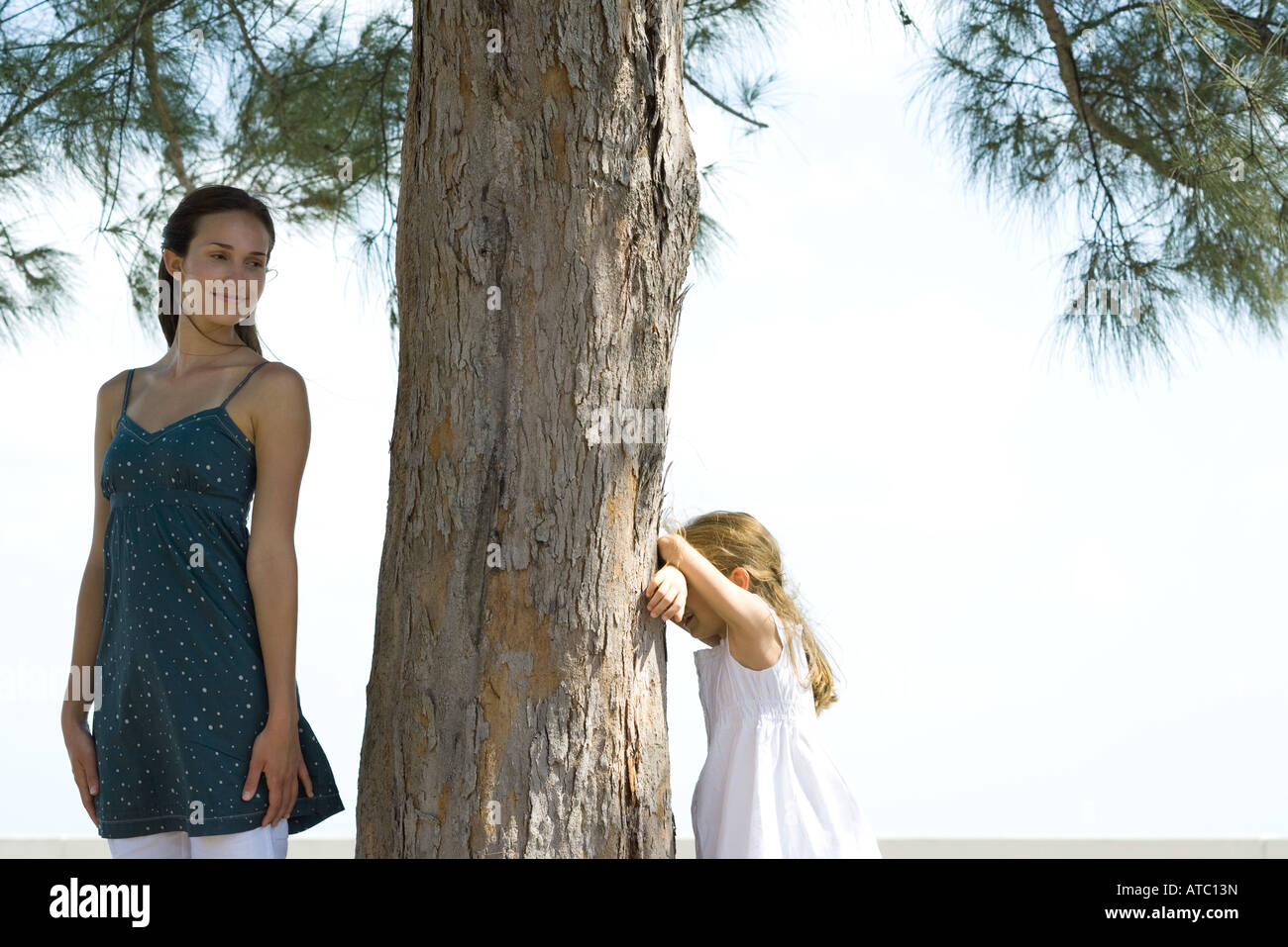 Two sisters playing hide-and-seek together Stock Photo