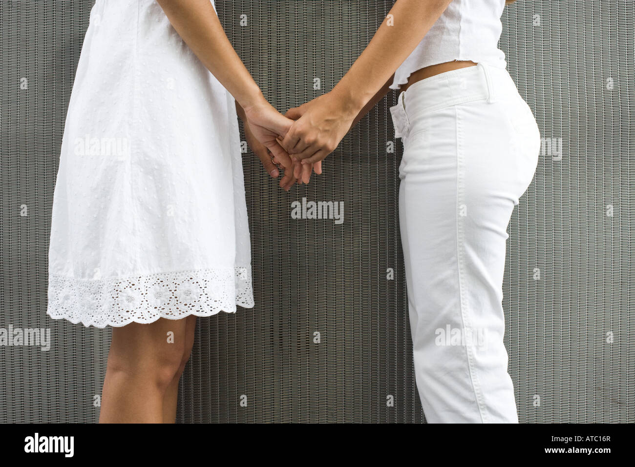 Two Girls Holding Hands Teens Stock Photos & Two Girls ...