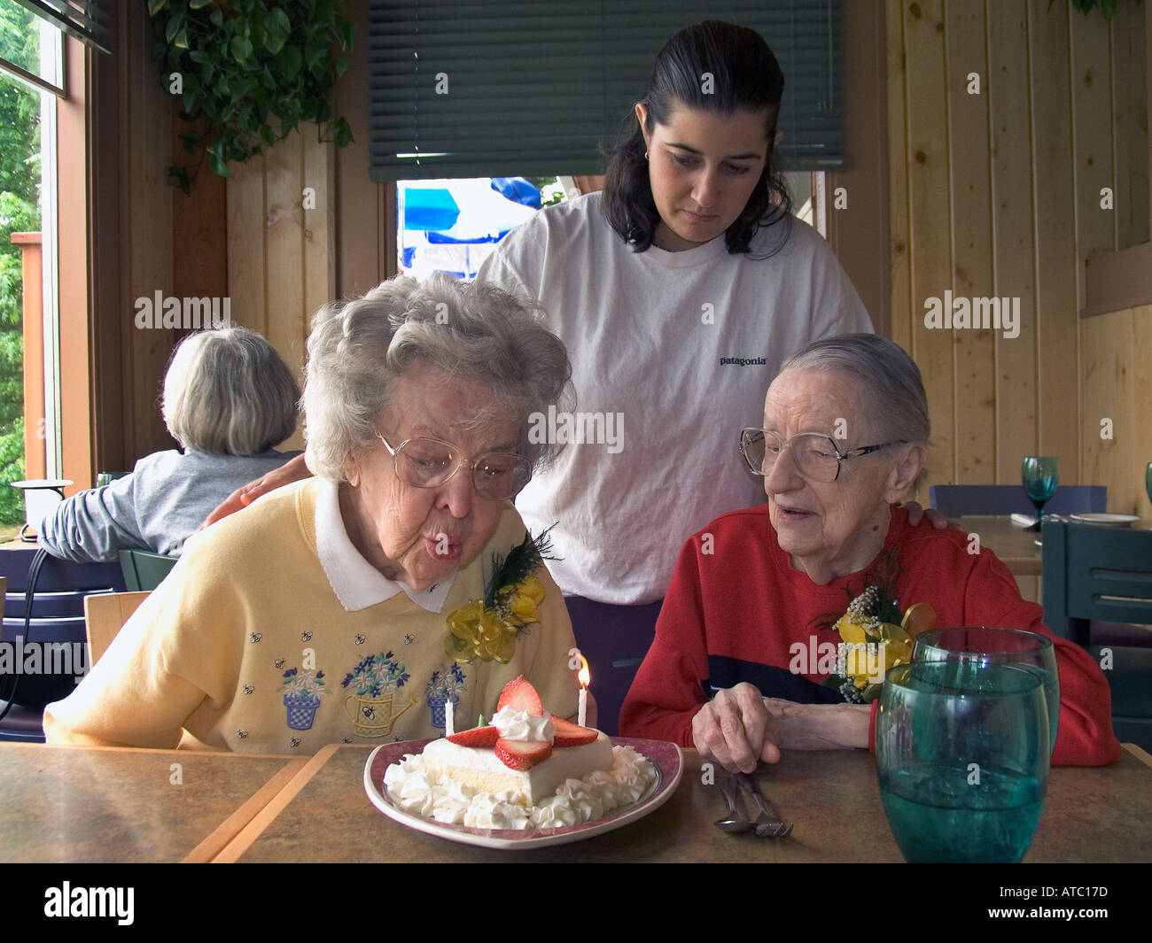 90 Year Old Woman Blows Out Birthday Candle On Cake As 88 Partner And Mid 30 Niece Watch