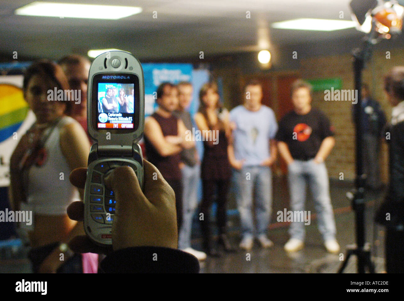 Taking a photograph of a popular spanish band called Hombres G with a celullar phone - Stock Image