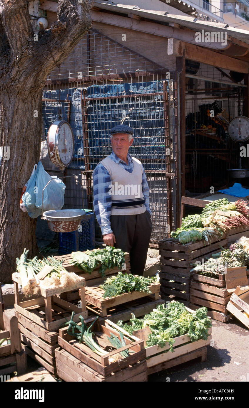 A stallholder selling fresh vegetables on a market north of Corfu s San Rocco Square in the Old Town district - Stock Image