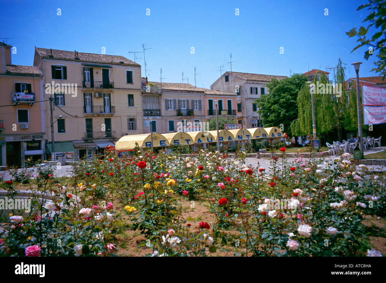Covers shade customers from the sun bearing down over Corfu s San Rocco Square Stock Photo