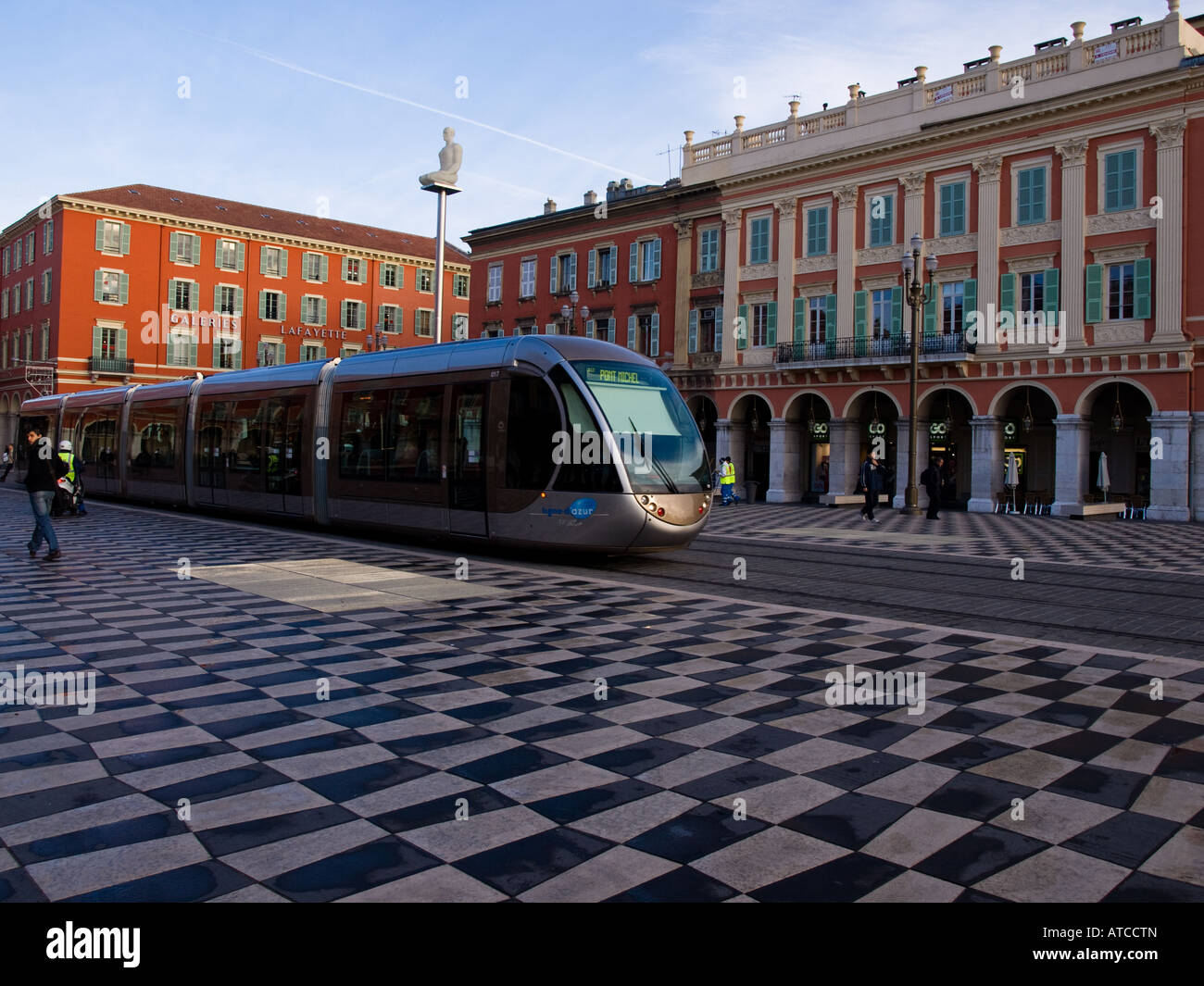 A tram pulls into Place Masséna in Nice, France. - Stock Image