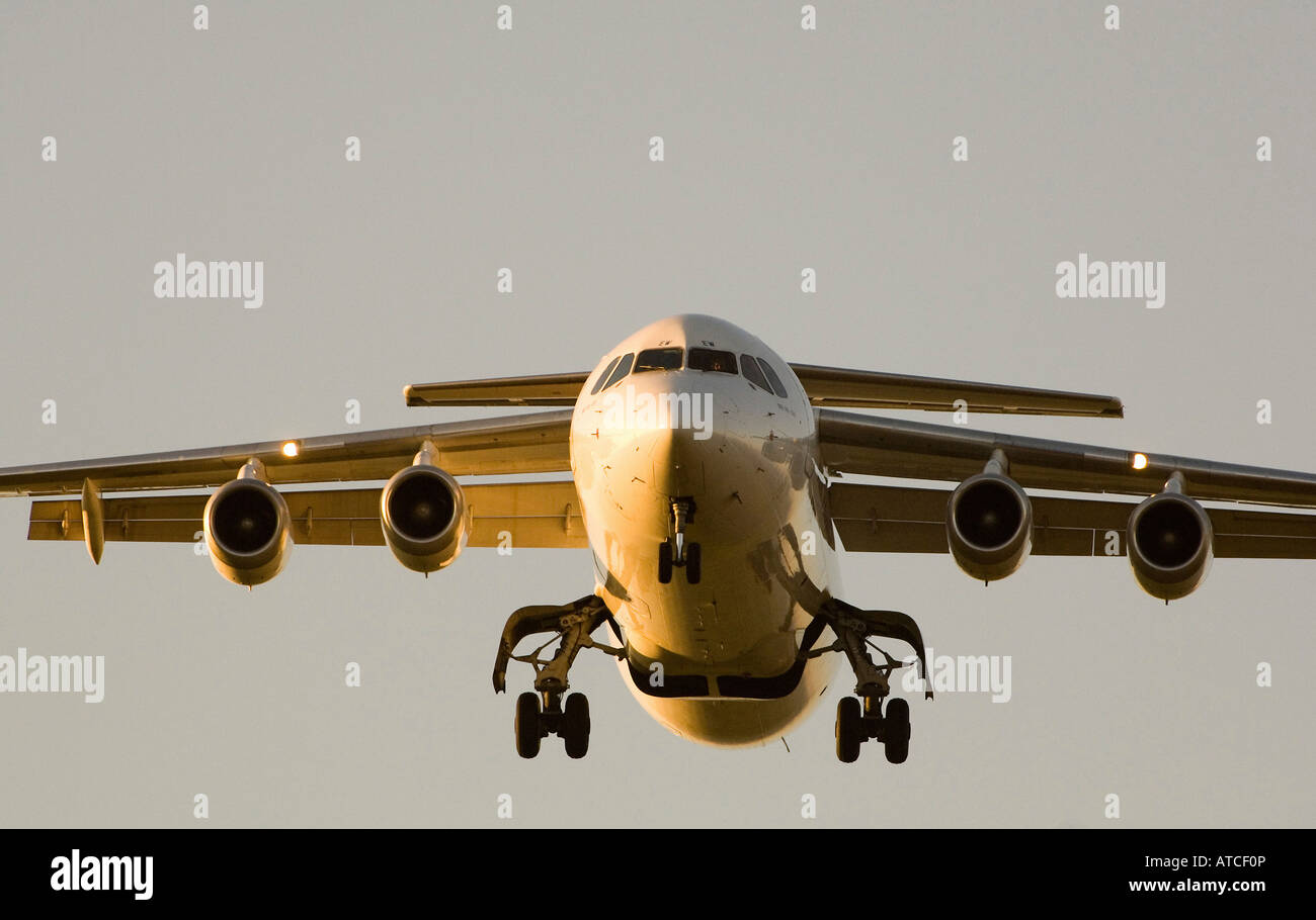 An airplane landing at the airport in Zurich, Switzerland - Stock Image