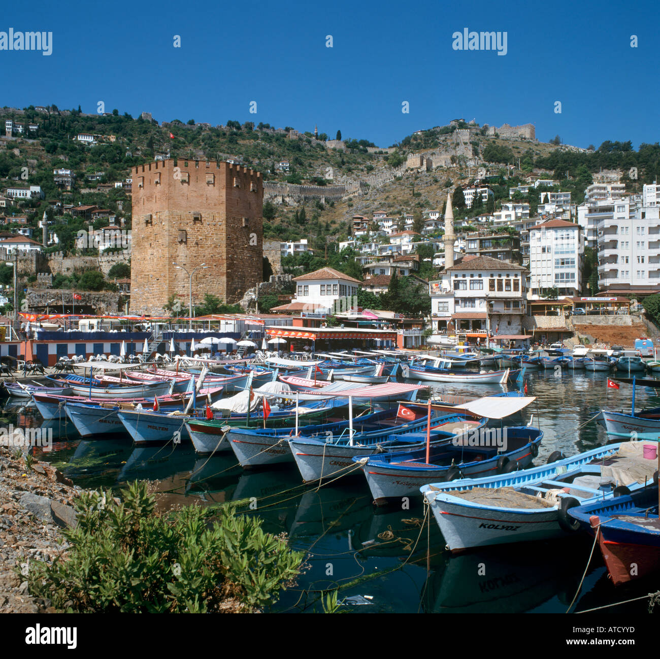 Harbour and Red Tower (Kisil Kule) with the Castle behind, Alanya, Mediterranean Coast, Turkey - Stock Image