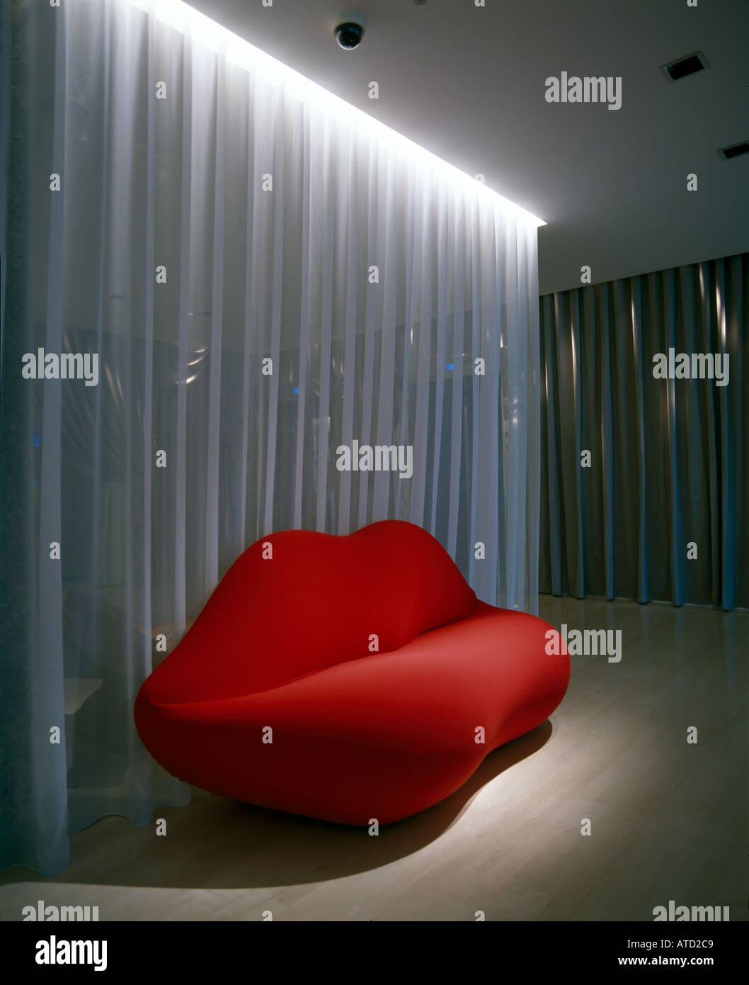 Lips Sofa In Reception Area. Architect: Philippe Starck