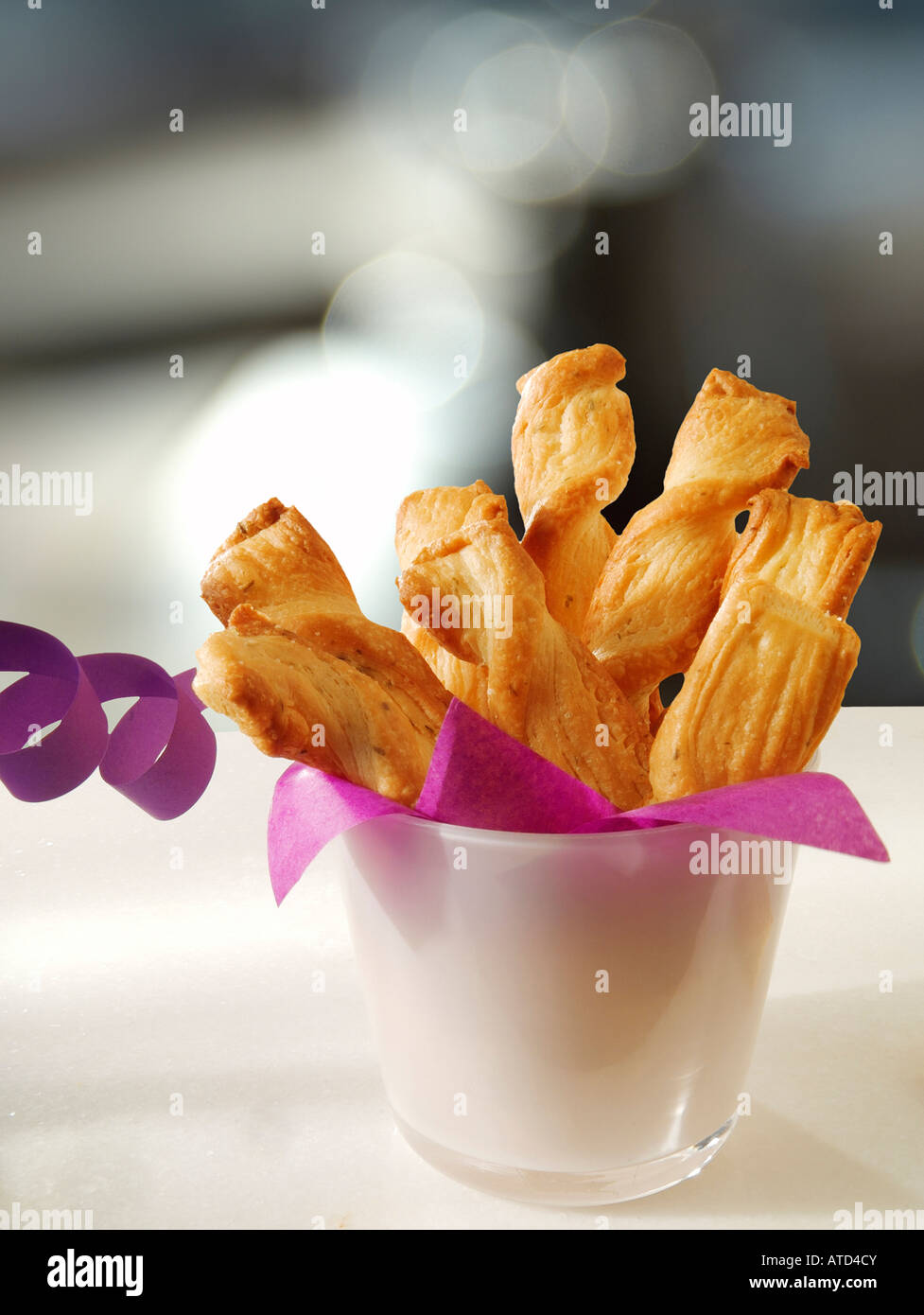 Cheese straw with party streamer - Stock Image