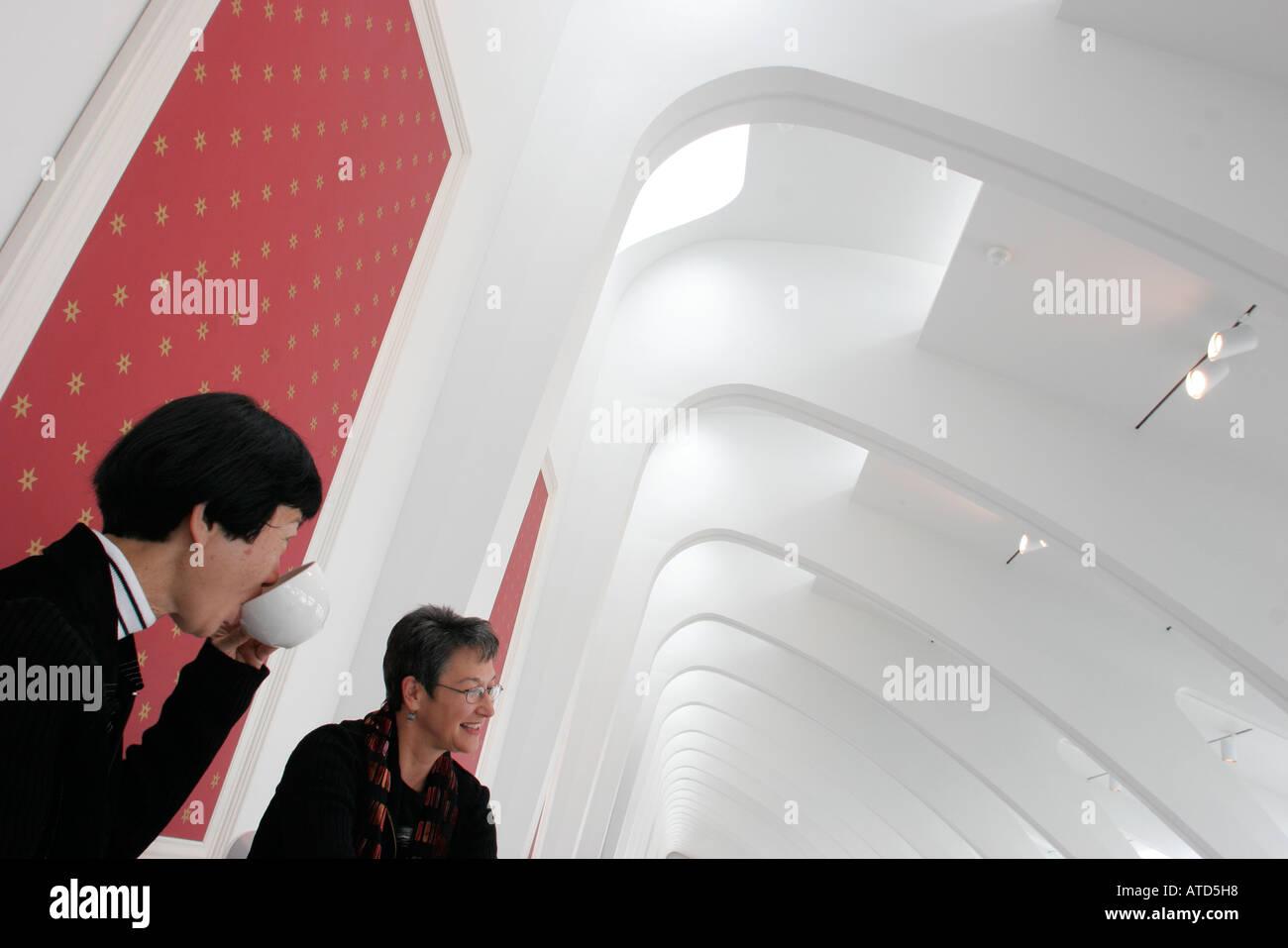 Wisconsin Milwaukee Milwaukee Art Museum Quadracci Pavilion Asian woman cup coffee - Stock Image