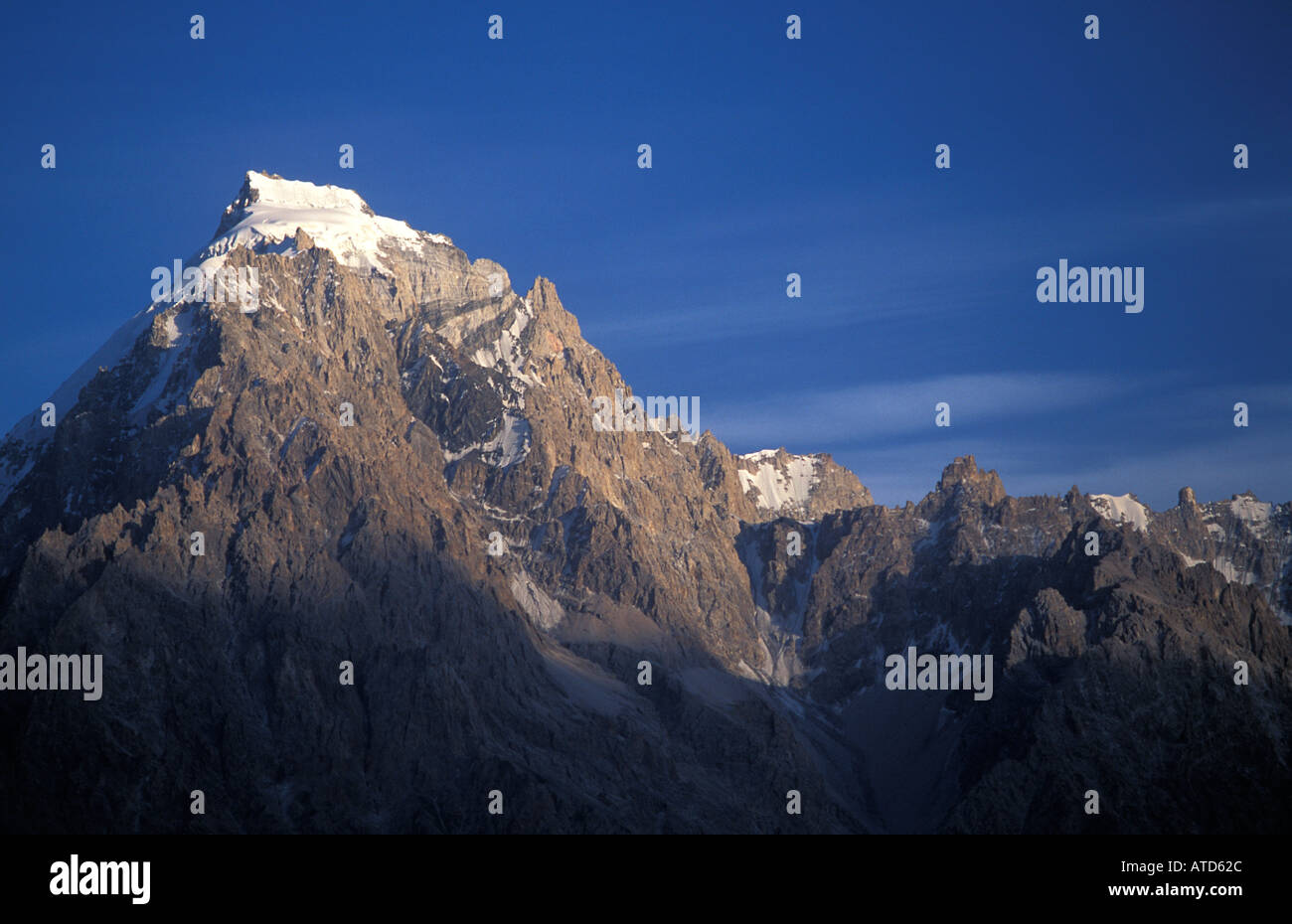 Spectacular mountain backdrop at Sust a frontier town in the N end of the Pakistani end of the Karakoram Highway Stock Photo