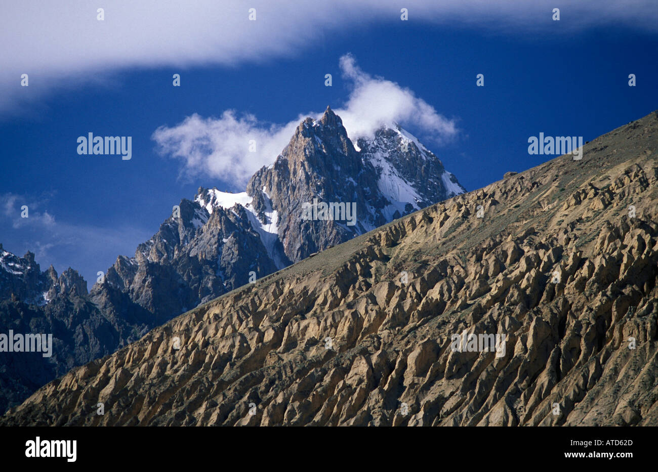 Spectacular mountain backdrop at Sust a frontier town in the N end of the Pakistani end of the Karakoram Highway Pakistan - Stock Image