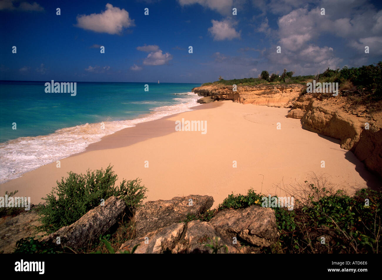 Waves wash onto Cupecoy beach on the Caribbean island of St Maarten - Stock Image
