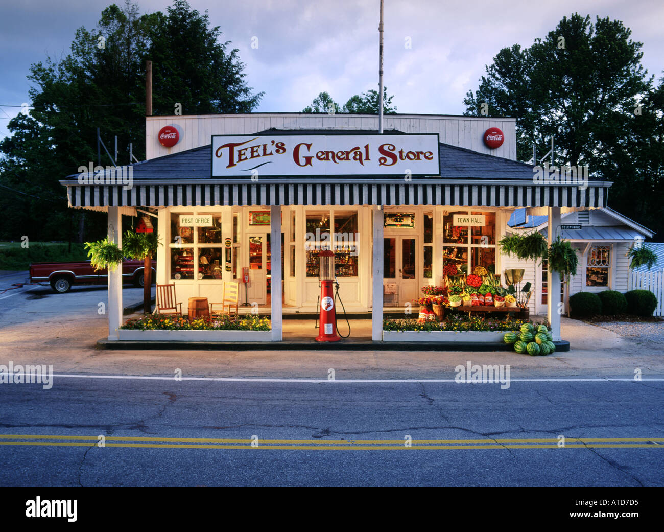 Old Time General Store With Old Fashioned Gas Pumps Stock Photo
