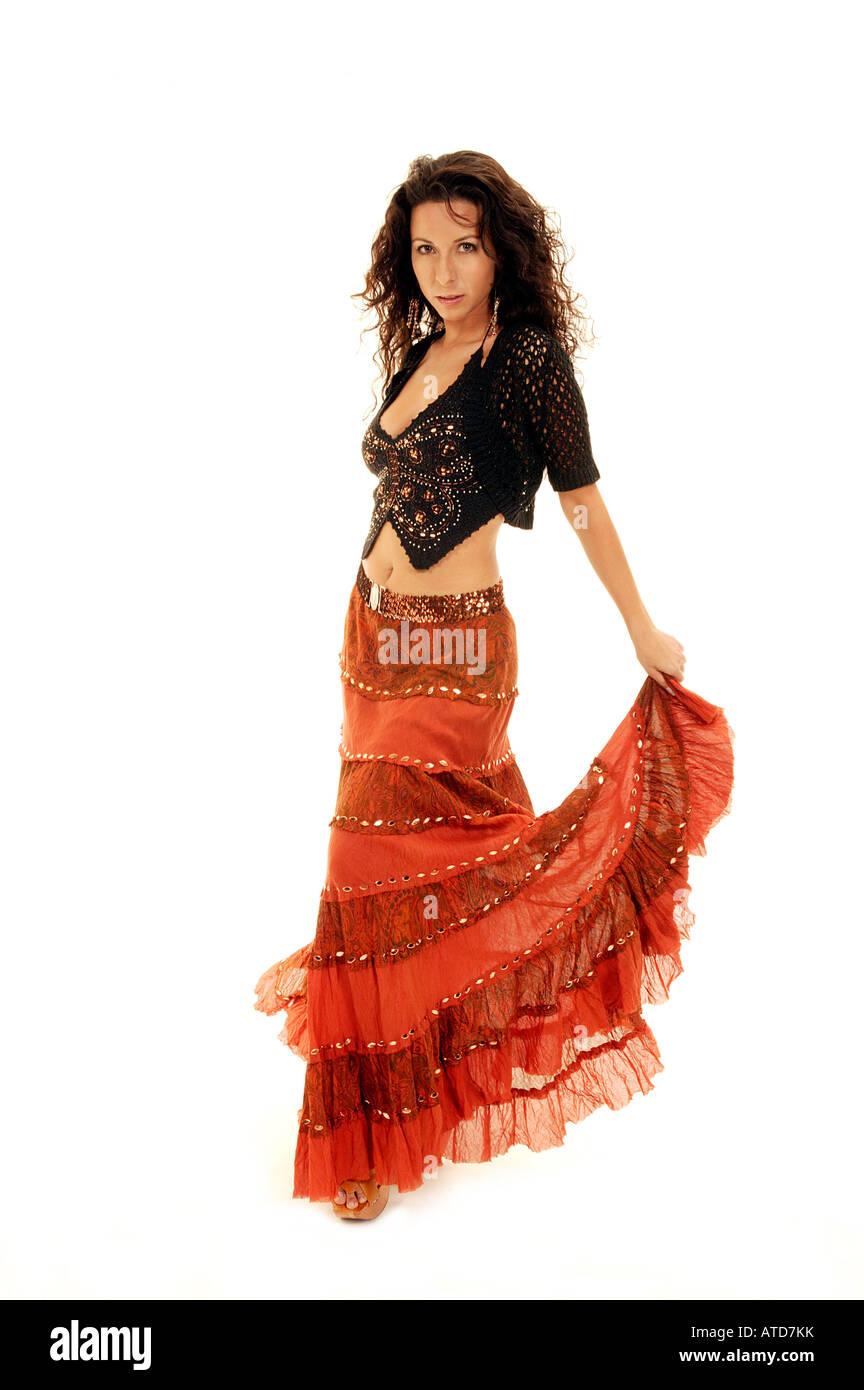 Dancer Holding Orange Skirt - Stock Image