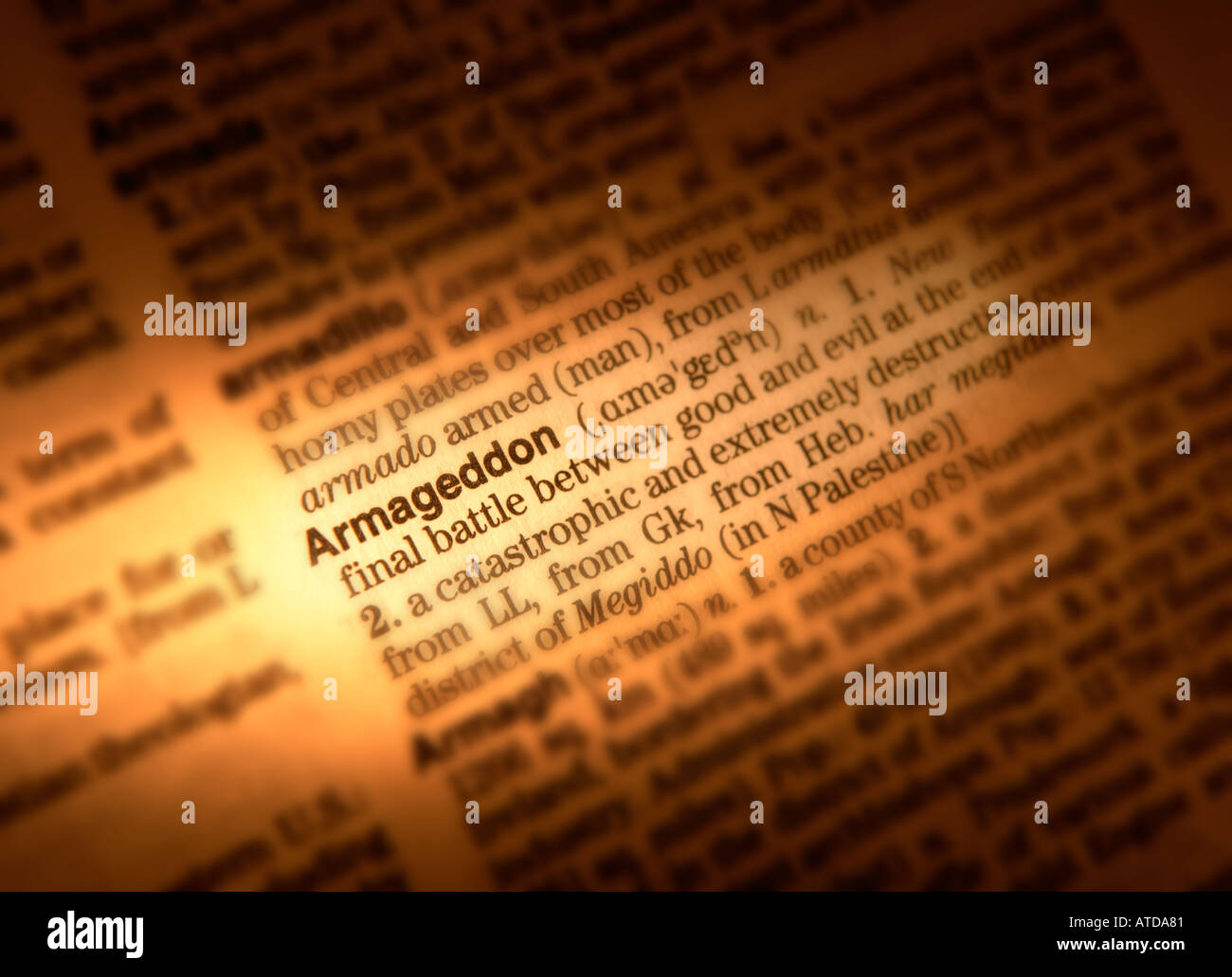 CLOSE UP OF DICTIONARY PAGE SHOWING DEFINITION OF THE WORD ARMAGEDDON - Stock Image