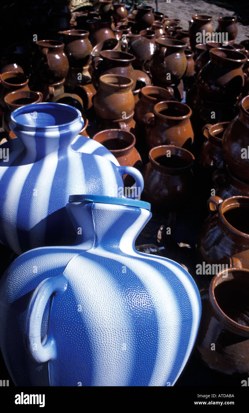 Selection of modern and traditional water jugs for sale at market Chichicastenango Guatemala Stock Photo