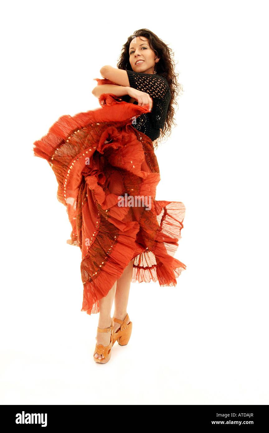 Dancer Twirling Orange Skirt - Stock Image