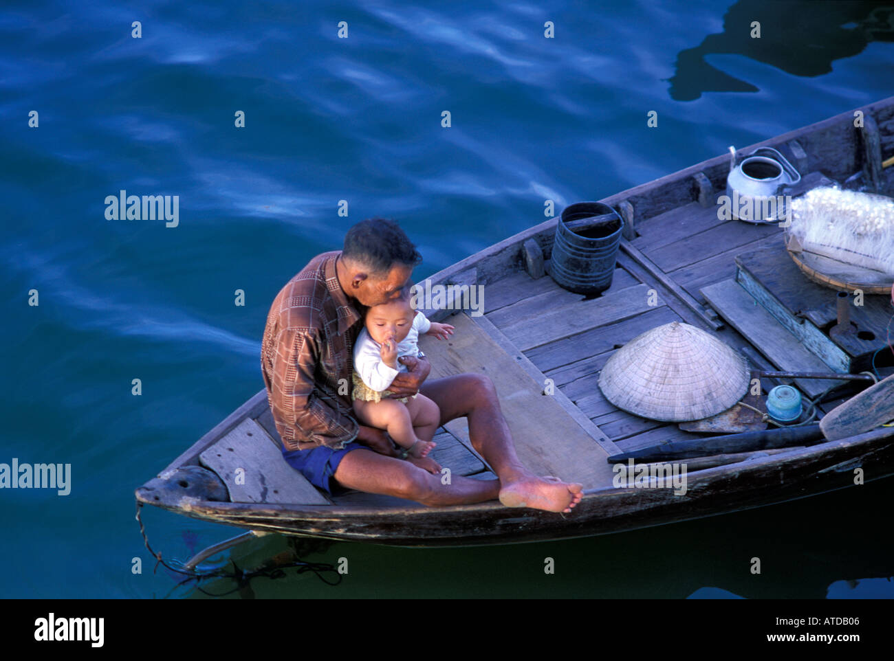 Vietnamese family living on boats on the Thu Bon River Hoi An Vietnam Grandfather child - Stock Image