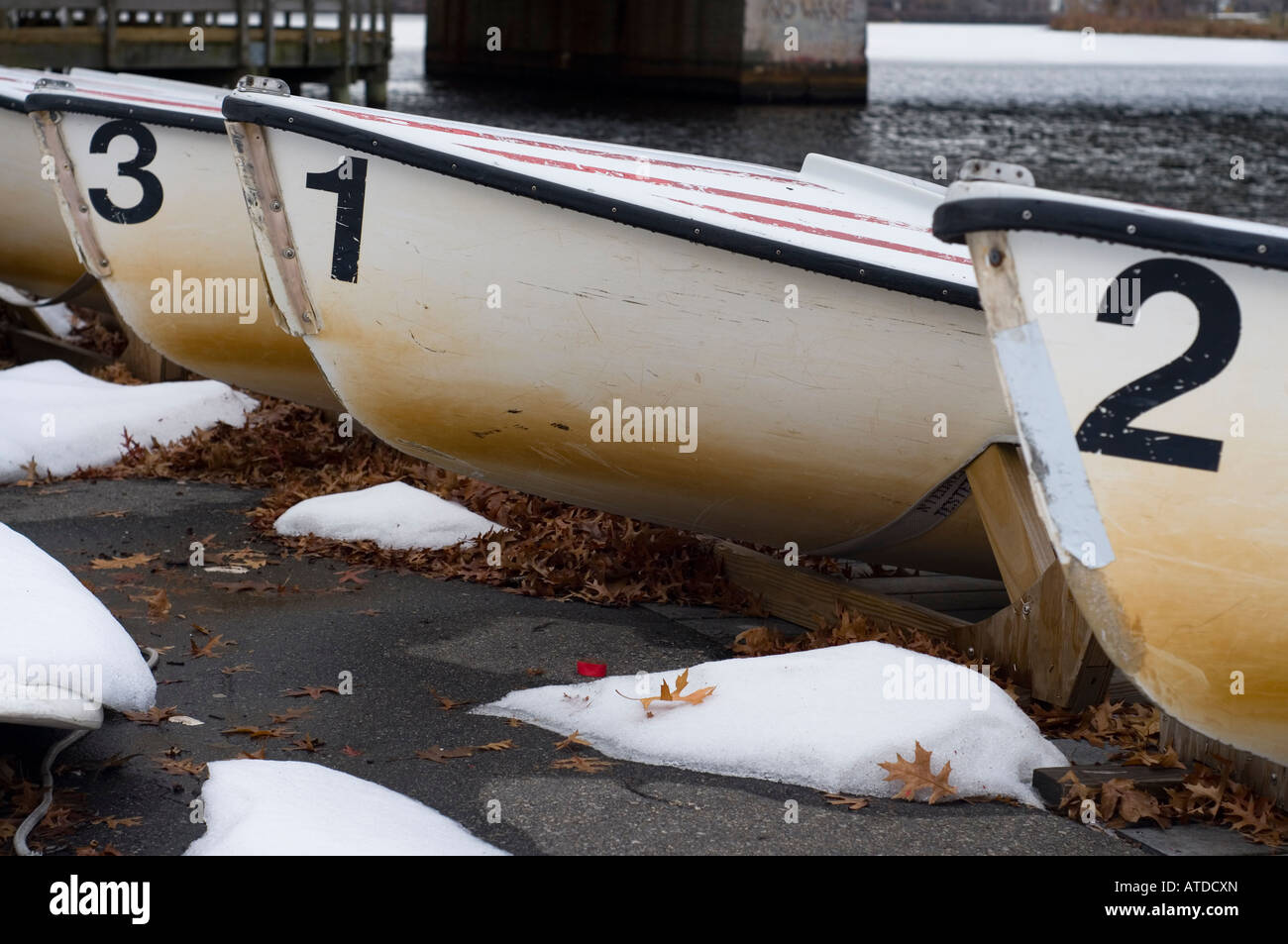Numbered sailboats pulled aground in the winter. - Stock Image