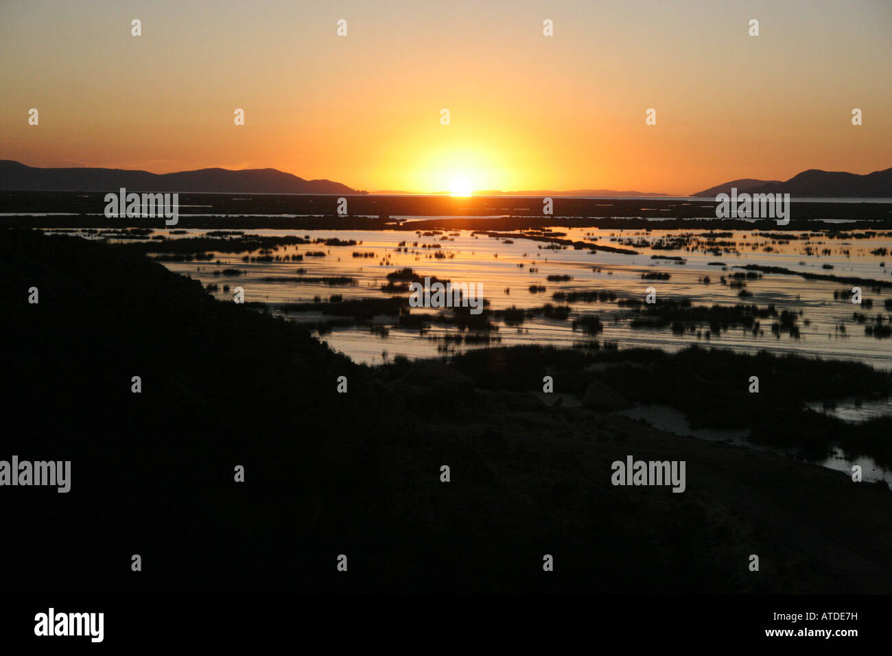 Sunrise over the reed islands of the Uros on Lake Titicaca Peru - Stock Image