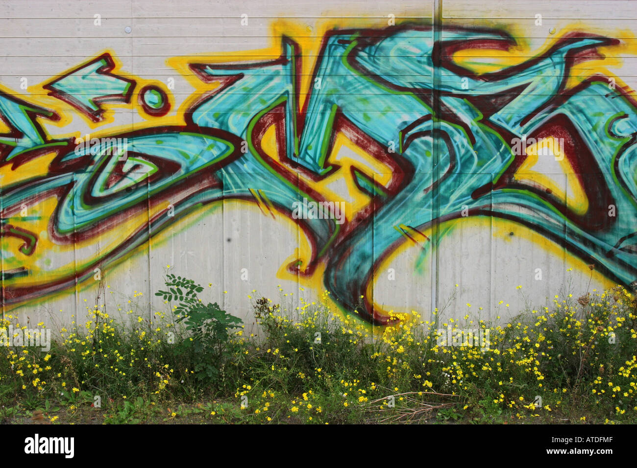 Concrete wall with colorfull graffitti - Stock Image