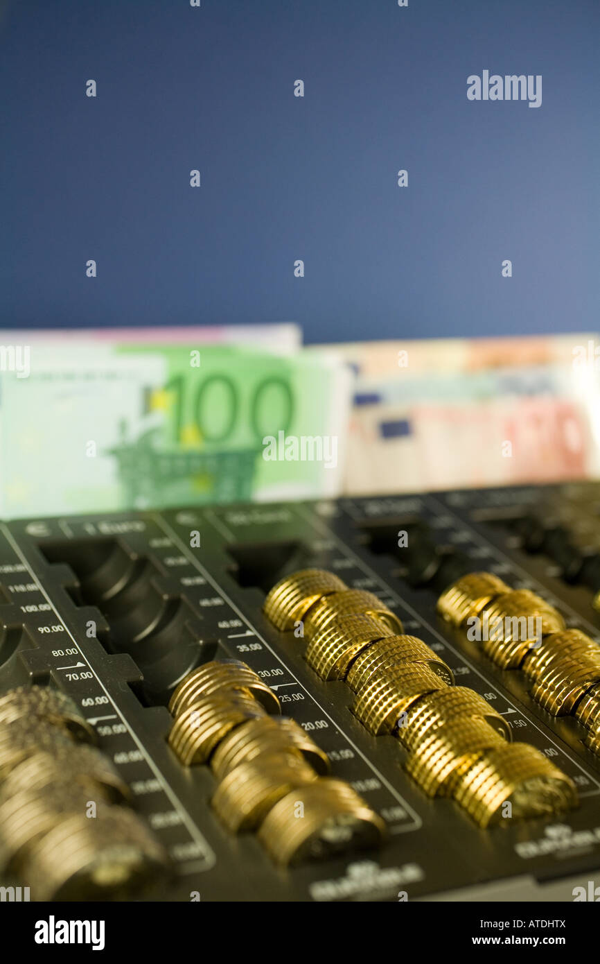 money box with euro notes and euro coins - Stock Image