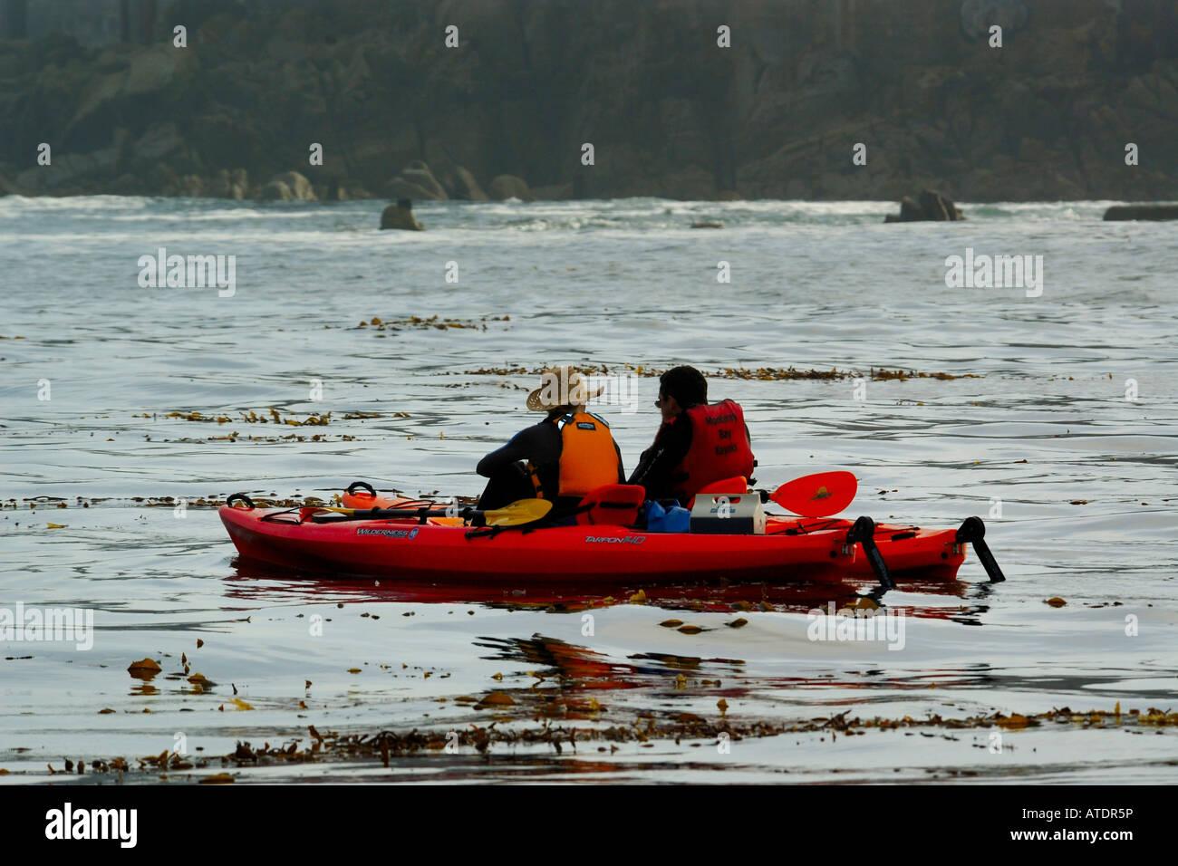 Sea kayaking in Monterey National Marine Sanctuary Monterey California Pacific Ocean - Stock Image