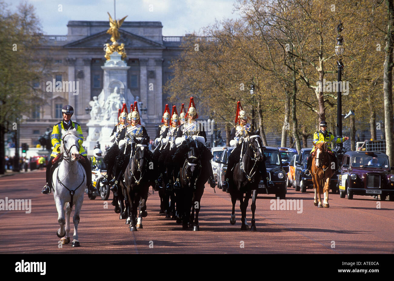A squadron of Household Cavalry Blues and Royals Buckingham Palace beyond The Mall London England UK - Stock Image