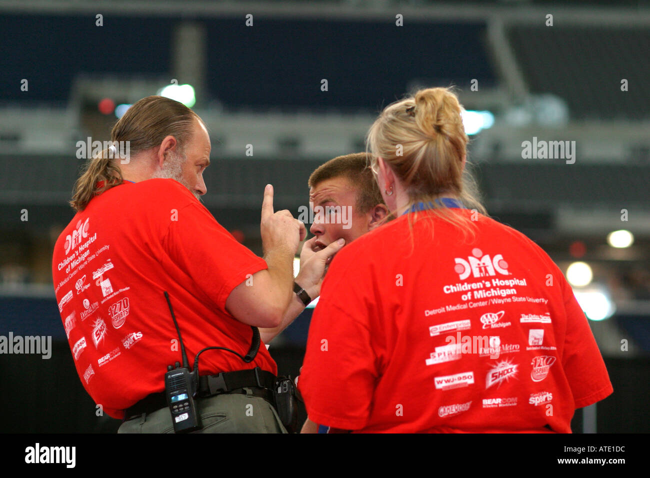 A trainer checks an injury during the wrestling competition in the AAU Junior Olympics in Detroit - Stock Image