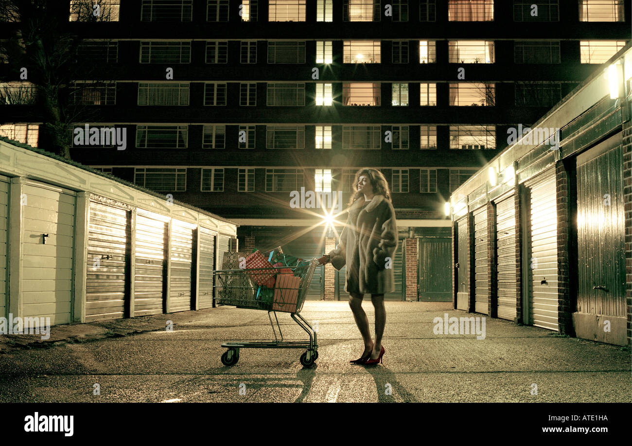 Lady standing with shopping Trolley - Stock Image