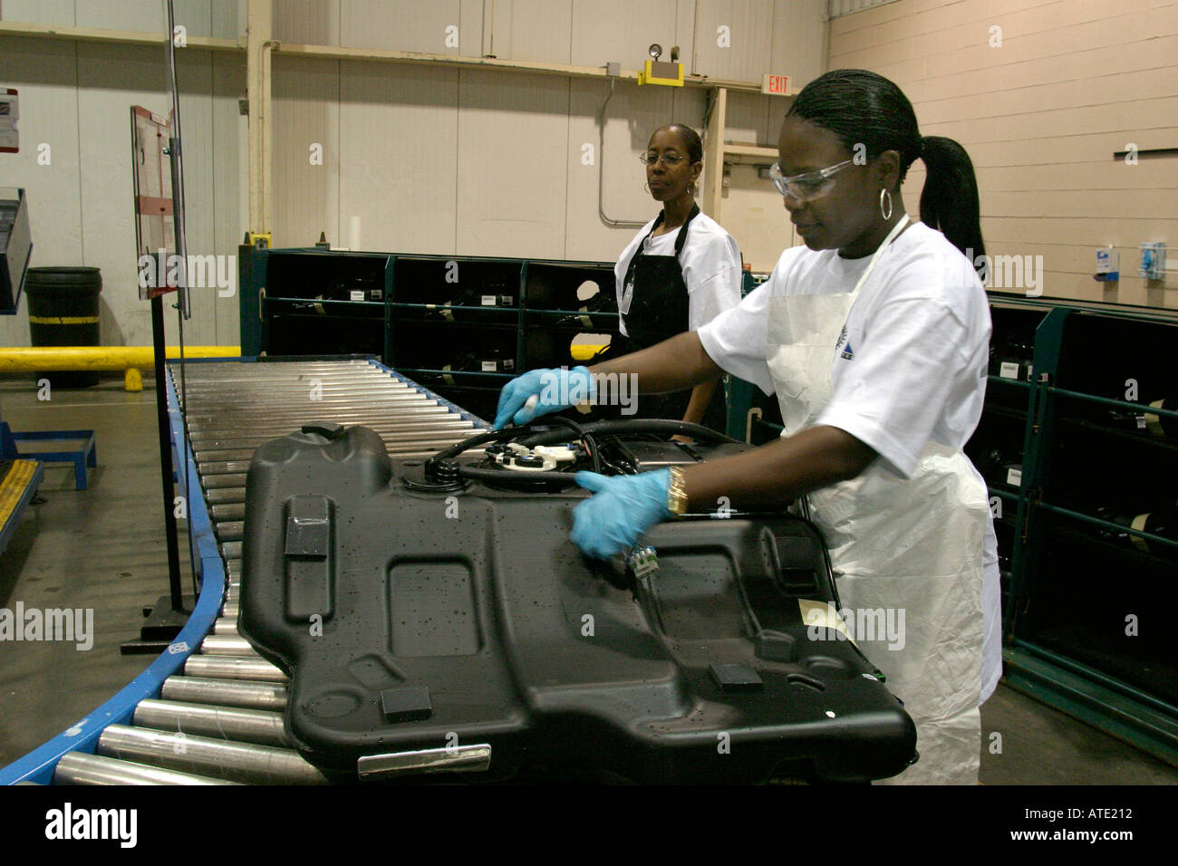 Worker at Vitec inspects newly manufactured automobile gas tank destined for General Motors - Stock Image