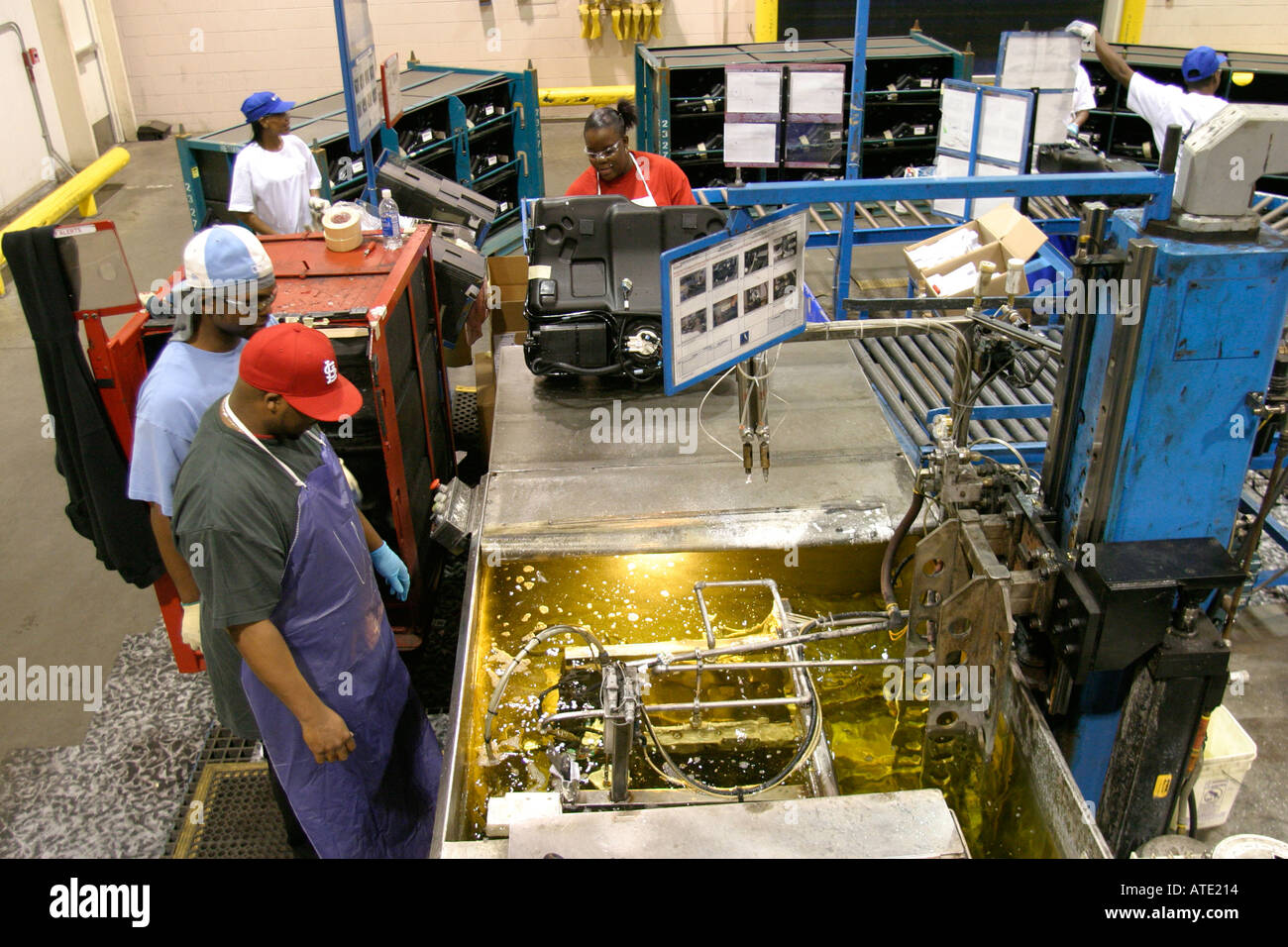 Workers at Vitec inspect newly manufactured automobile gas tanks destined for General Motors - Stock Image